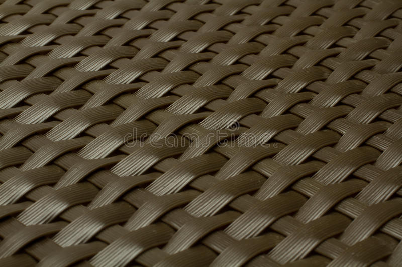 Wicker gray texture as background. Wicker texture as dark brown plastic background royalty free stock images
