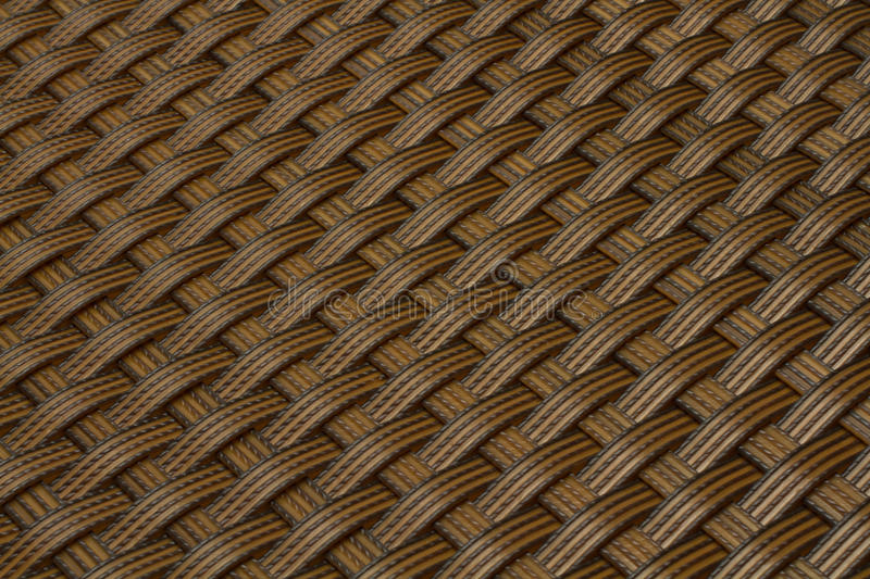 Wicker gray texture as background. Wicker texture as light brown plastic background stock photo