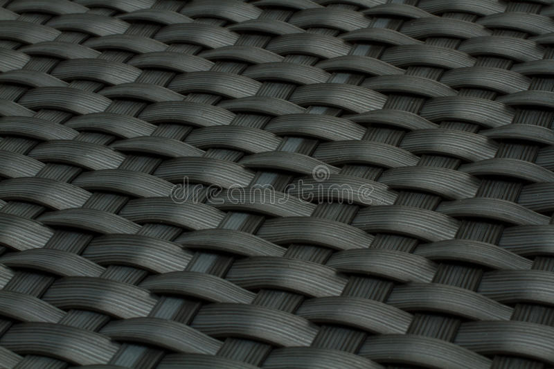 Wicker gray texture as background. Wicker texture as old gray plastic background stock image