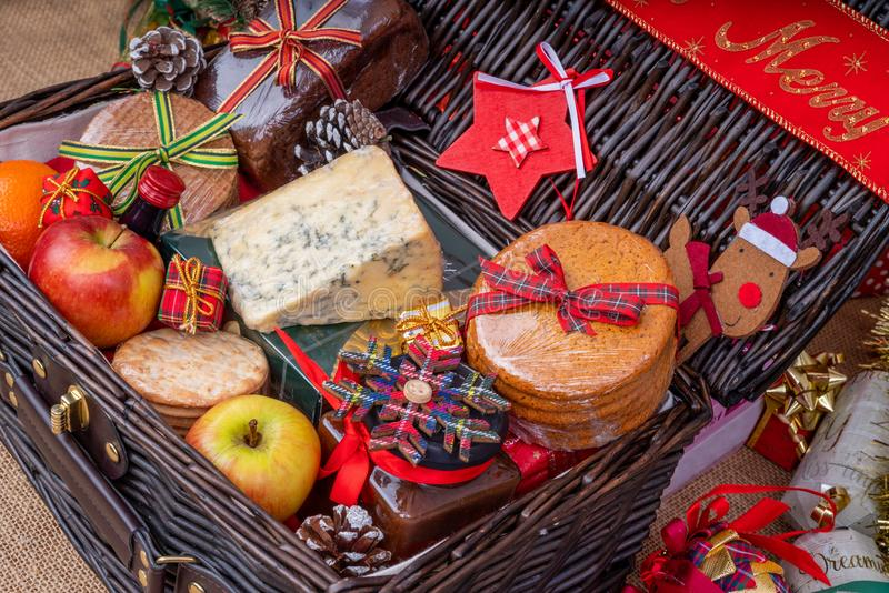 Christmas Food Hamper. Wicker Hamper loaded with Christmas Treats and Fruits stock photos