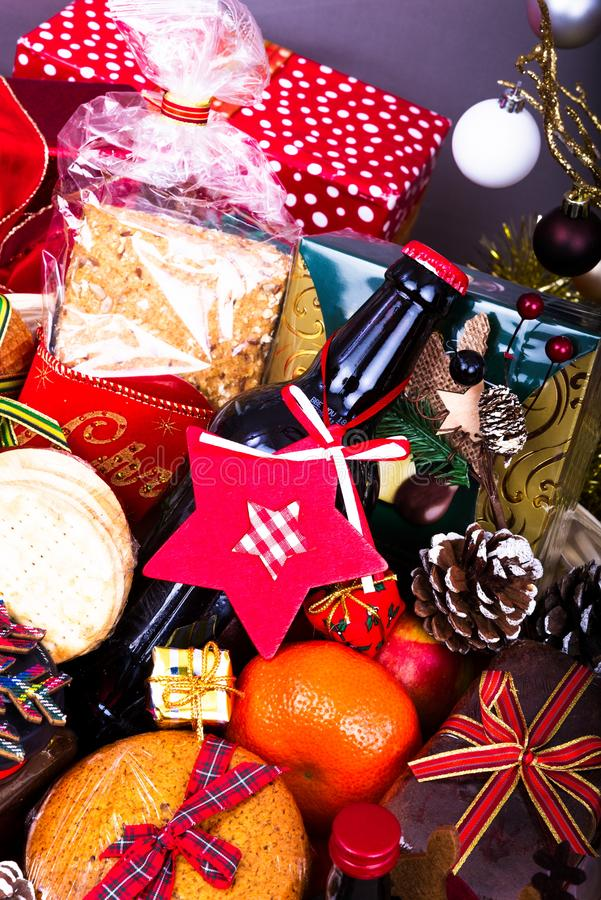 Christmas Food Hamper. Wicker Hamper loaded with Christmas Treats and Fruits stock images