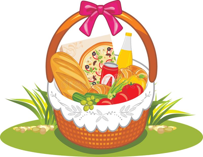 Wicker picnic basket with groceries stock images