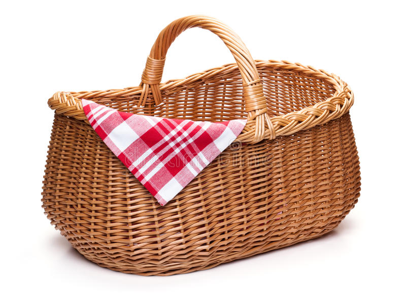 Wicker picnic basket with red checked napkin. royalty free stock photography