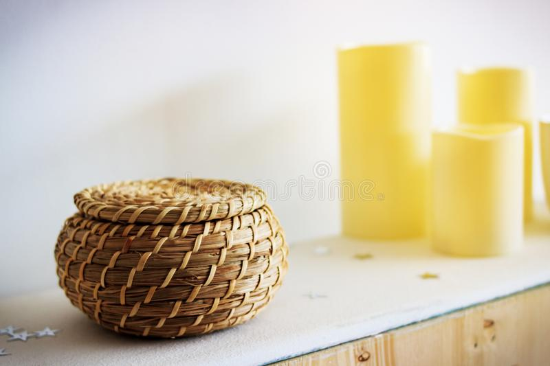 wicker pot in the interior and candles, wooden pot stock photo