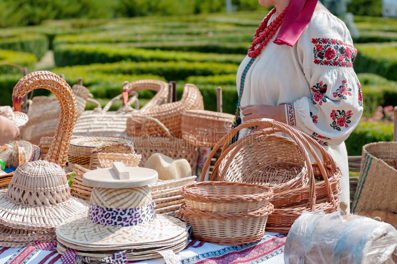 Wicker products, sale, fair on the square. The seller is the national costume of Ukraine royalty free stock photo
