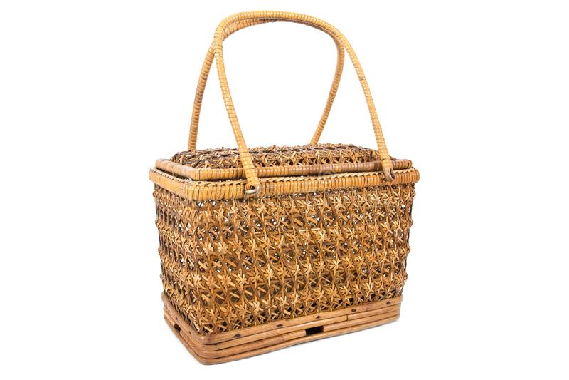 Wicker rattan handbag isolated on white background. Rattan bag isolated. On white stock image