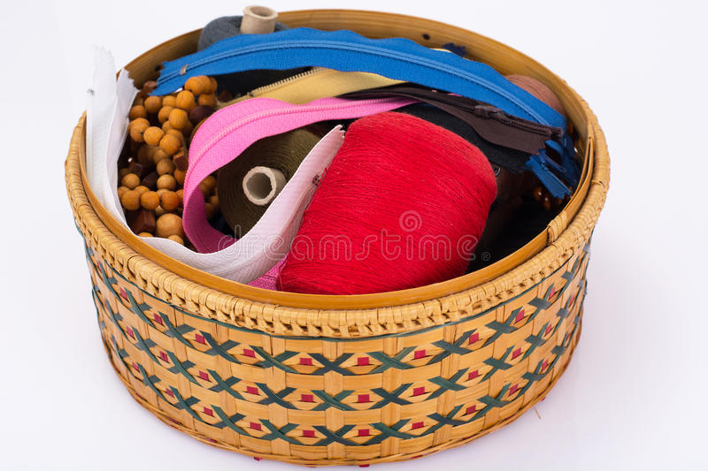 Wicker straw box for sewing accessories. Studio Photor stock photo