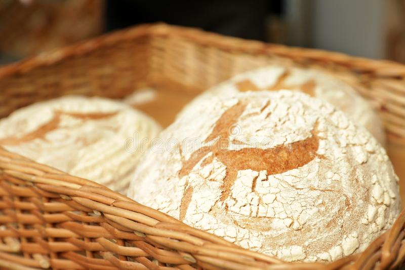 Wicker tray with loaves of bread in bakery stock photography