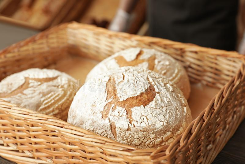 Wicker tray with fresh loaves of bread stock photos