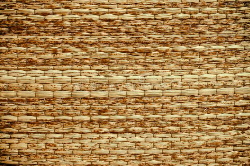 Wicker woven beige mat handmade background royalty free stock images