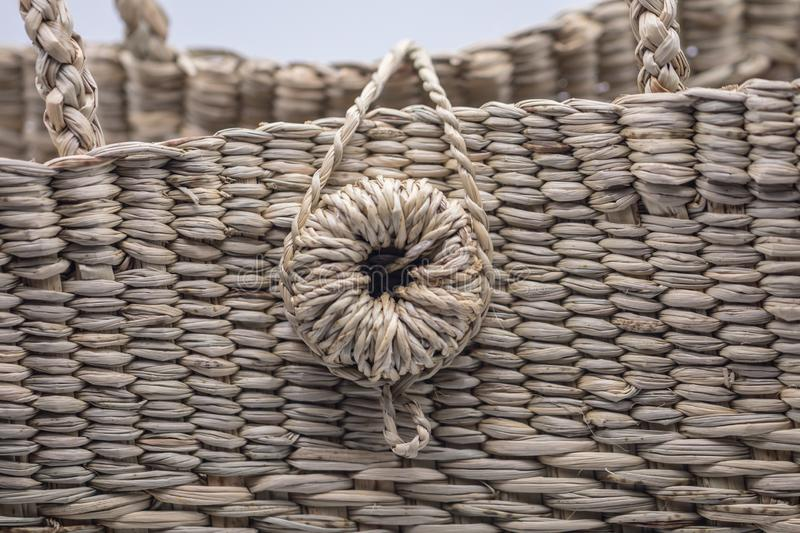 Wickerwork woman bag texture made from dry sedge isolate on white  background.Closeup surface texture of hand made craft work papy. Close up Wickerwork woman bag stock image