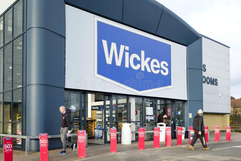 Wickes DIY store. Milton Keynes, UK - February 11, 2019. Customers enter a Wickes DIY store. Wickes is a home improvement retailer in the UK owned by Travis royalty free stock photo