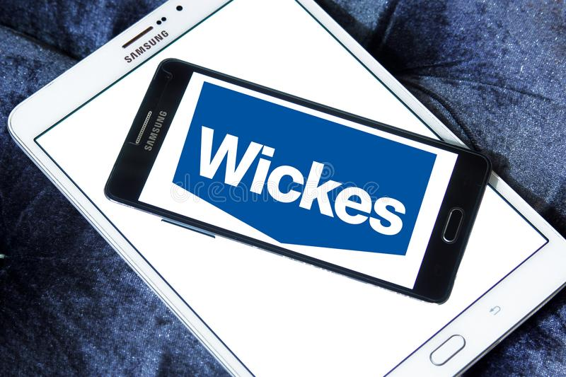 Wickes retailer logo. Logo of Wickes retailer on samsung mobile. Wickes is a British home improvement retailer and garden centre, based in the United Kingdom royalty free stock image
