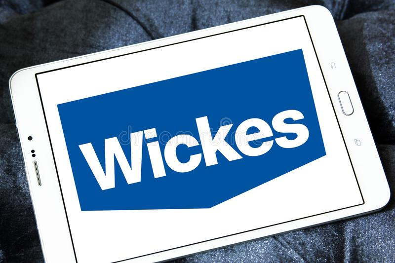 Wickes retailer logo. Logo of Wickes retailer on samsung tablet. Wickes is a British home improvement retailer and garden centre, based in the United Kingdom royalty free stock photo
