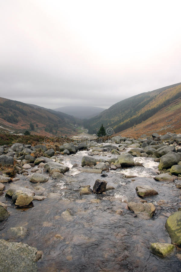 The Wicklow Mountains National Park, river and waterfall. The Wicklow Mountains National Park, river and waterfall into a valley on a cloudy day royalty free stock images