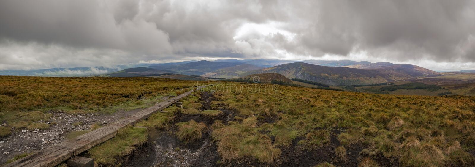 Wicklow way trail leading to the vibrant irish panorama landscape stock photography