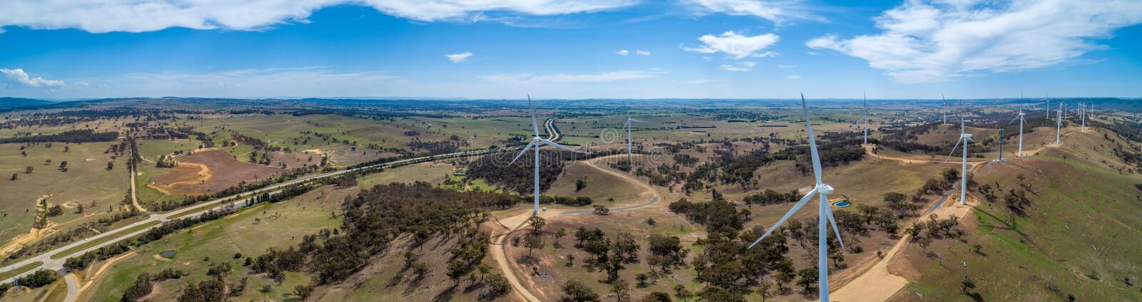 Panorama of Hume Highway and wind farm in beautiful Australian countryside. royalty free stock images