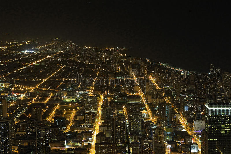 Wide aerial view of Chicago, Illinois at night royalty free stock photos