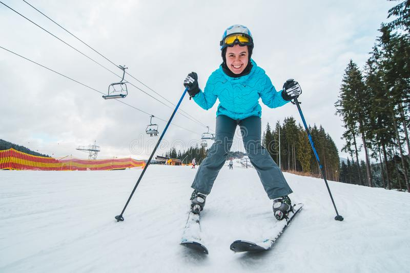 Wide angel picture of skiing young adult woman stock images