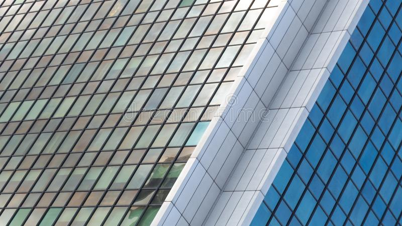 Wide angle abstract background view of steel light blue high rise commercial building skyscraper made of glass exterior stock images