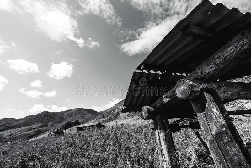 Draw-well in mountains, greyscale shooting stock photos