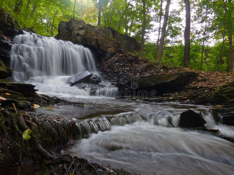 Dividend Pond Waterfall low view. Wide angle of Dividend Pond waterfall shot at ground level royalty free stock photo
