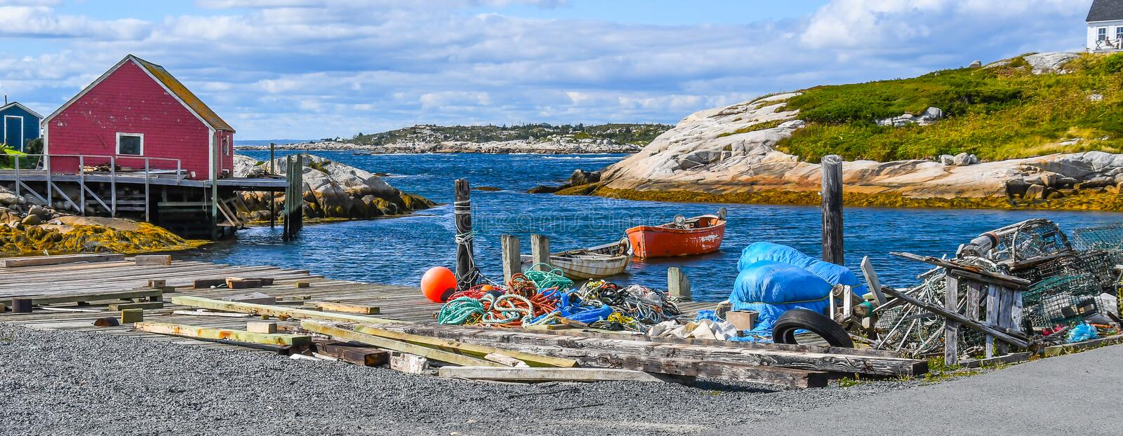 Wide Angle Landscape of Lobster Fishermen`s Colorful Debris on the Pier stock images