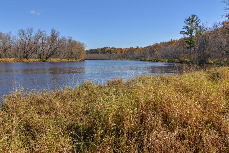 Wide angle landscape of the vast St. Croix River separating Wisconsin and Minnesota - sunny day with beautiful blue skies.  stock photo