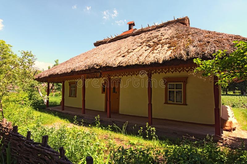Wide angle landscape view of typical clay house called Shunok tavern or bar. Pereyaslav-Khmelnitsky Museum of Folk Architecture stock photos