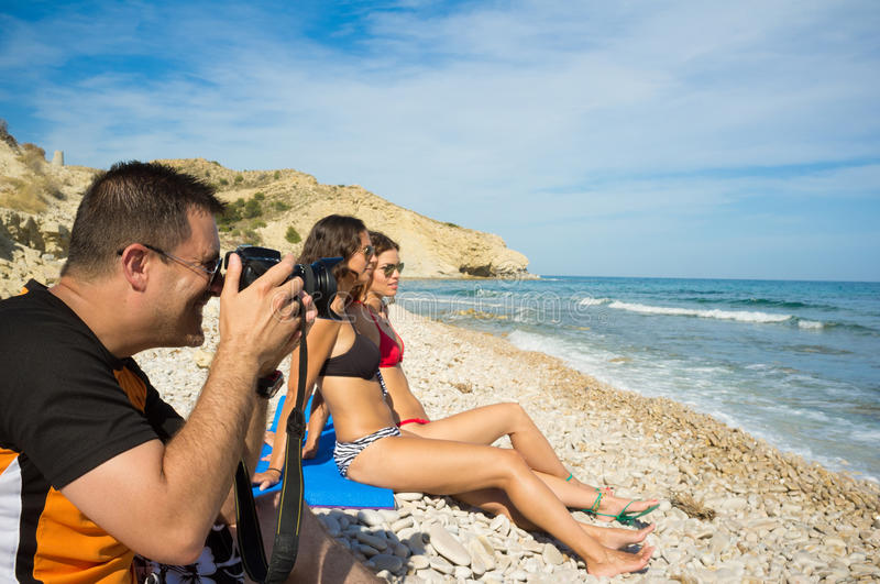 Wide angle lens. Letting the guy shoot the girls unnoticed stock images
