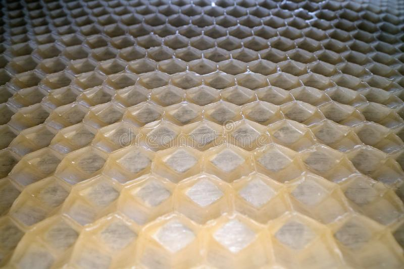 Wide angle macro shot of honeycomb wax. Abstract view of honey comb hexagon shape pattern.  royalty free stock photos
