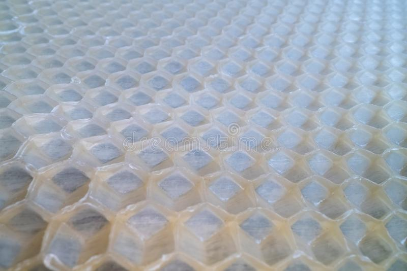 Wide angle macro shot of honeycomb wax. Abstract view of honey comb hexagon shape pattern.  stock photography