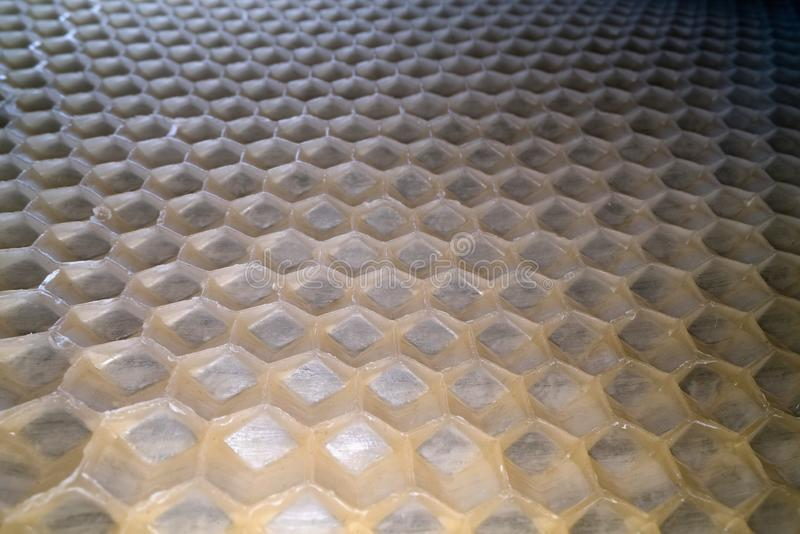 Wide angle macro shot of honeycomb wax. Abstract view of honey comb hexagon shape pattern.  royalty free stock images