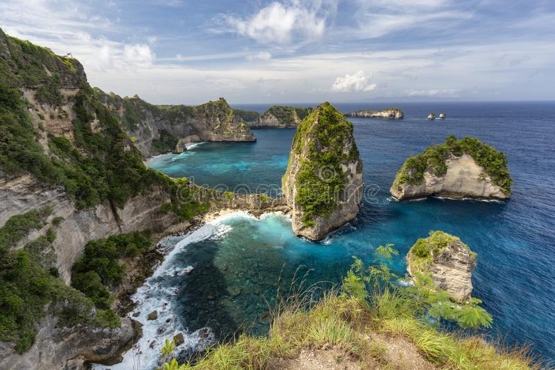 Wide Angle Nusa Penida. Wide angle view of the small island of Nusa Batumategan and Nusa Batupadasan from the Raja Lima shrine on Nusa Penida Island near Bali royalty free stock image