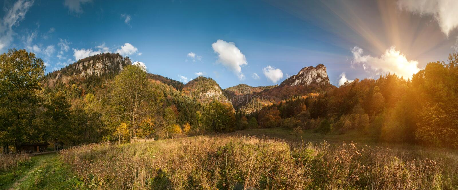 Wide angle panorama of autumnal mountain landscape royalty free stock photos