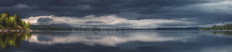 Wide dramatic panorama landscape with lake water, mountain range stock image