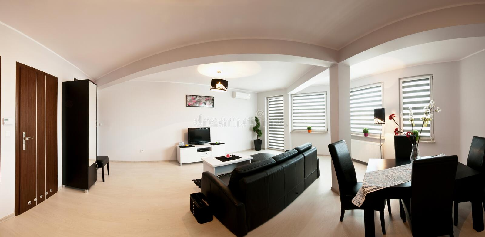 Apartment room panorama. Wide angle panorama of an elegant, modern apartment room with dining table, comfortable sofa and television stock images