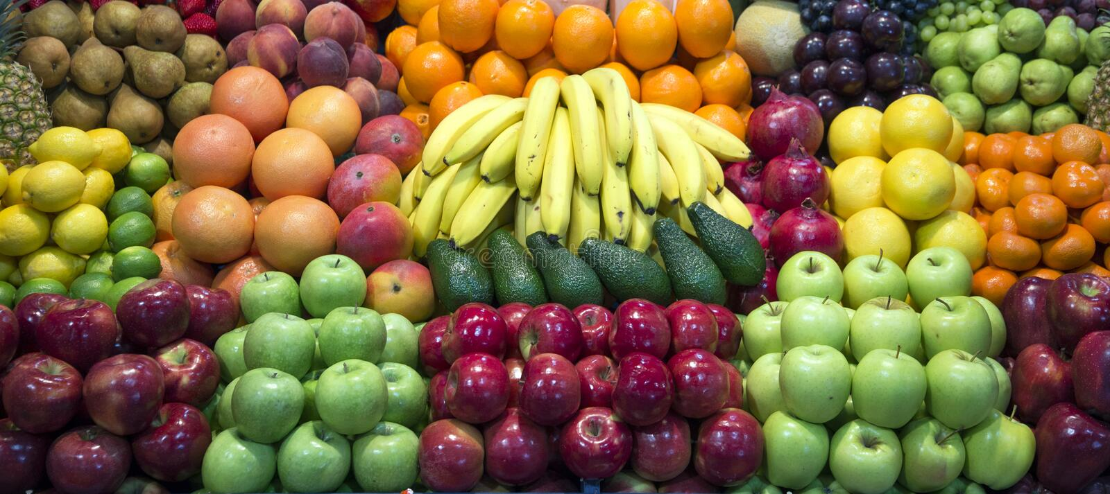 Wide angle photo of many colorful fruits on farmers market stand stock image