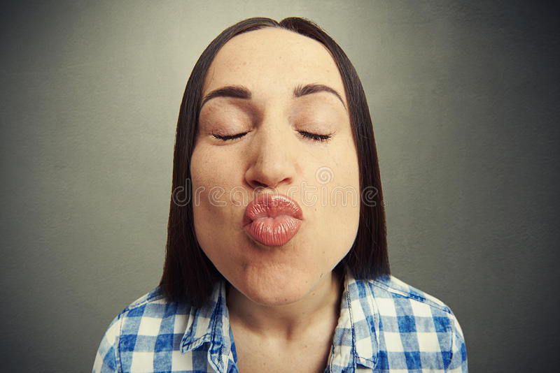 Wide angle portrait of kissing woman royalty free stock photos
