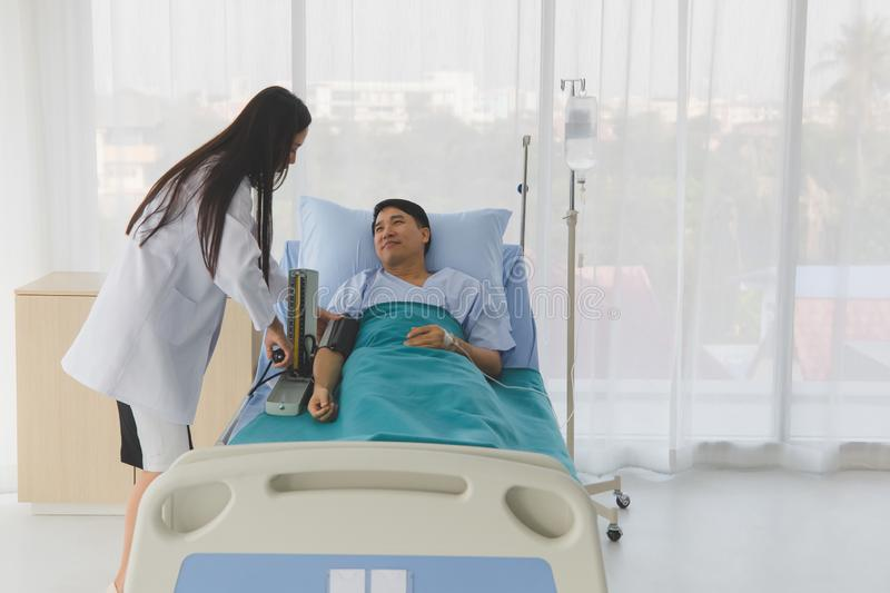 Doctor check patient`s blood pressure in hospital royalty free stock photography