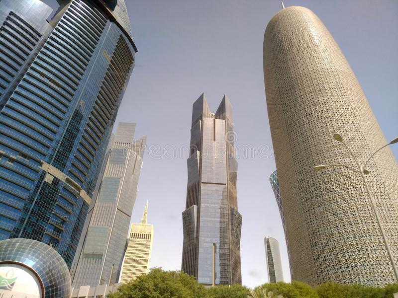 Wide Angle Shot of Modern Blue High Skyscrapers in Doha city, Middle East. stock photos