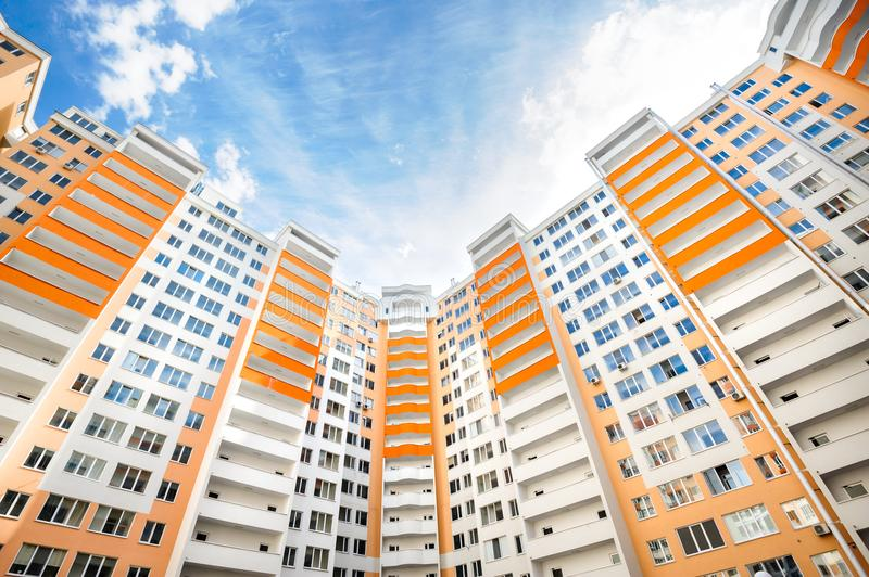 Wide angle shot of new residential buildings. Wide angle shot of new apartments residential buildings exterior stock images