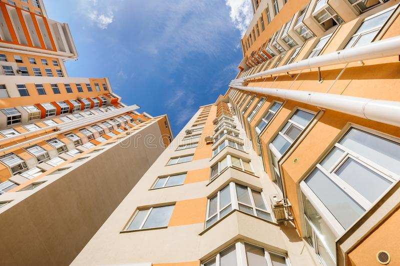Wide angle shot of new residential buildings. Wide angle shot of new apartments residential buildings exterior stock image