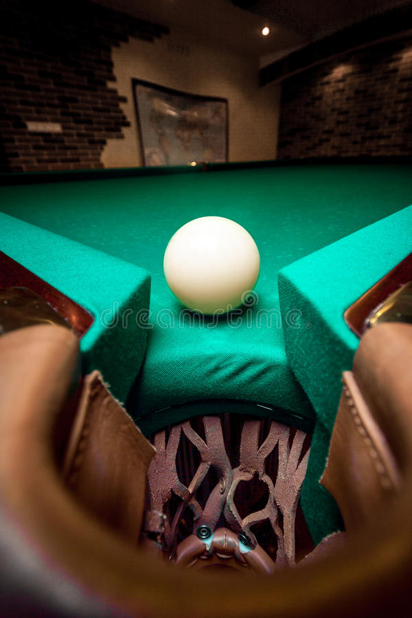 Wide angle shot white ball in billiard pocket. Closeup wide angle shot white ball in billiard pocket royalty free stock photo