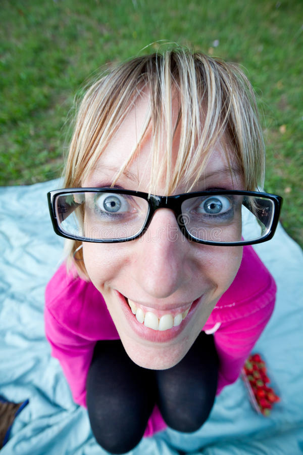 Wide Angle Shot Of Young Woman With Glasses Stock Photo