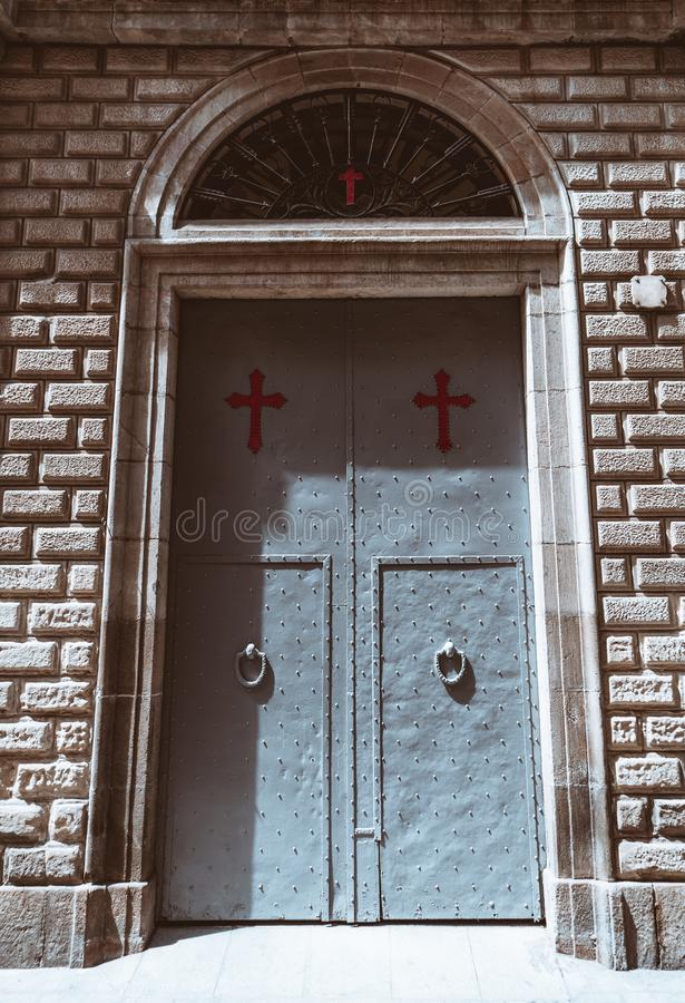 Metal church gates with red crosses stock photo