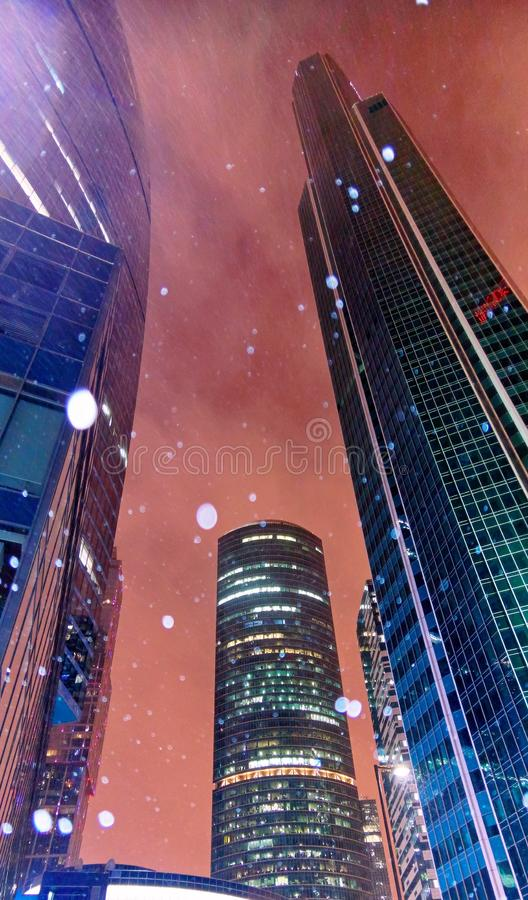 Wide angle vibrant view of heavy snowfall in downtown skyscraper area of winter Moscow in evening royalty free stock photo