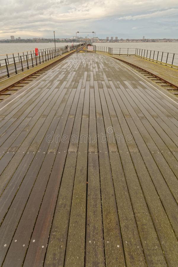London, Southend: pier deck and railway. Wide angle view along southend Pier, Essex on a freezing cold day england, uk stock images