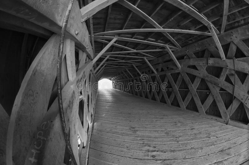 Wide angle view of a covered bridge with the word Hope painted on one board. stock image