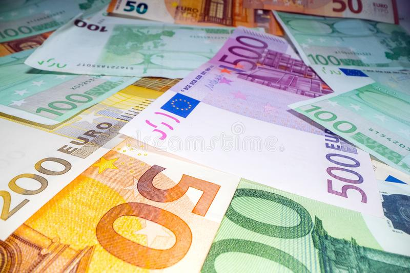 Wide angle view of euro notes background stacked on top of each other. Euro money banknotes, pile of money, cash, stack of bills. stock photo